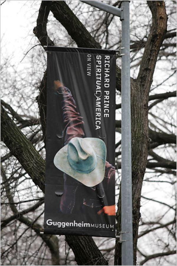 Баннер выставки Ричарда Принса Spiritual America в музее Гуггенхайма