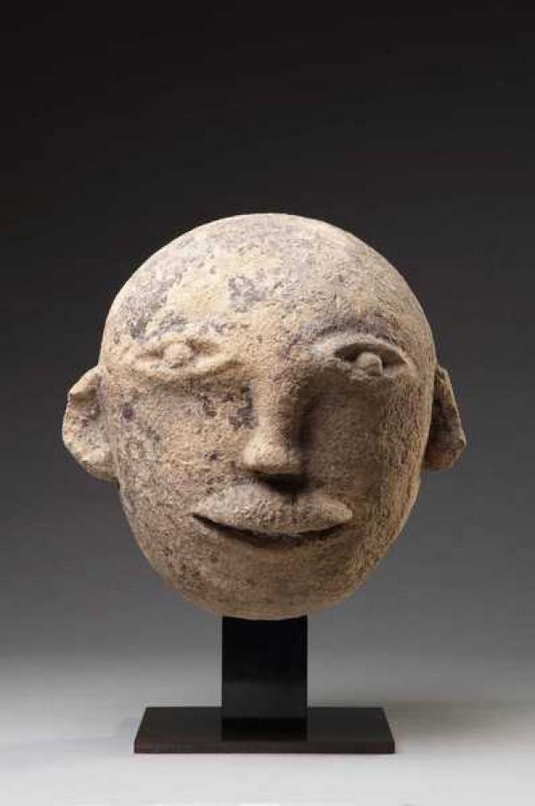 Языческая  кельтская скульптура — мужская голова. I  в. до н. э.  — I в. н.  э.
